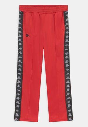 JASNA UNISEX - Spodnie treningowe - racing red