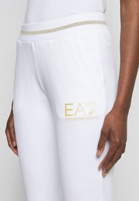 EA7 Emporio Armani - Tracksuit bottoms - white - 4