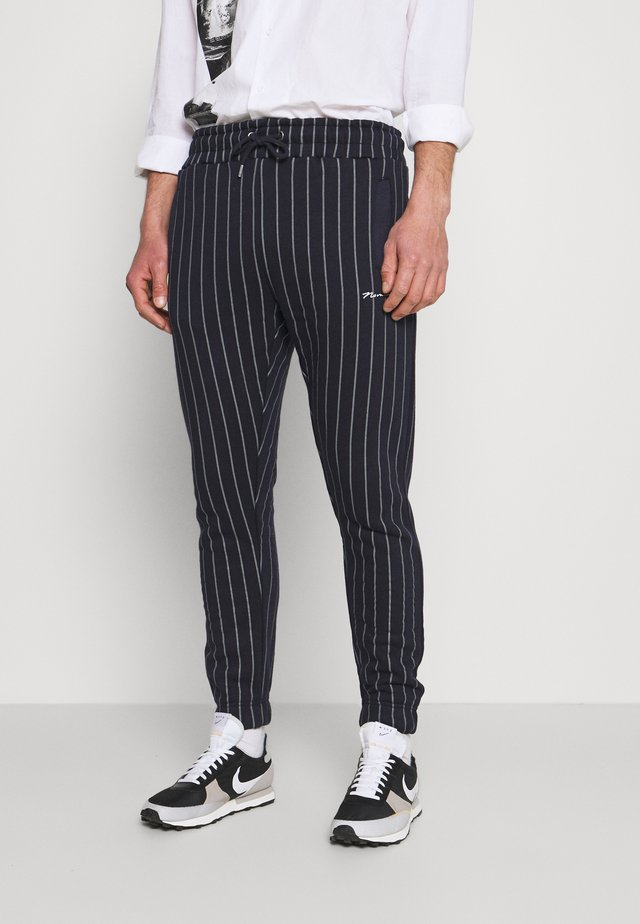 STRIPE JOGGER - Teplákové kalhoty - navy