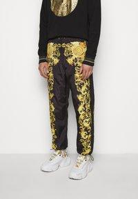 Versace Jeans Couture - PRINT BAROQUE - Tracksuit bottoms - black - 0