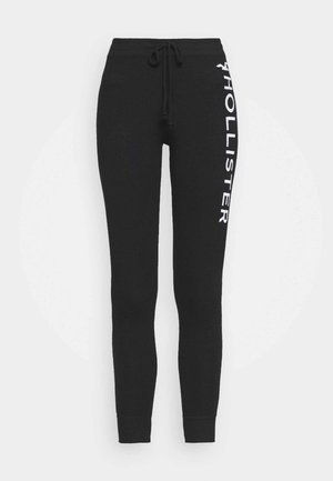 TIMELESS LOGO - Tracksuit bottoms - black