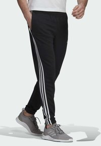 adidas Performance - ESSENTIALS FRENCH TERRY TAPERED 3-STRIPES JOGGERS - Pantalones deportivos - black - 2