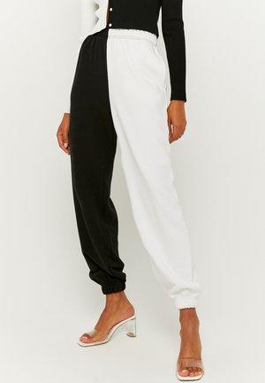 MISSING TITLE - Pantaloni sportivi - white
