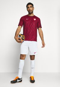 Nike Performance - TÜRKEI SHORT - Sports shorts - white/sport red - 1