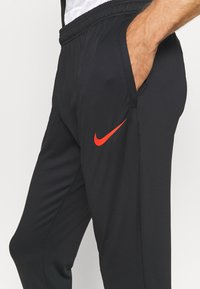 Nike Performance - FC PANT - Spodnie treningowe - black/iridescent/habanero red - 3