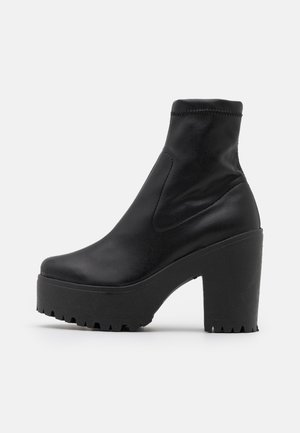 SOCK BOOT - Platform ankle boots - black