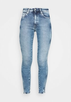 HIGH RISE SKINNY ANKLE - Jeans Skinny Fit - blue twist hem