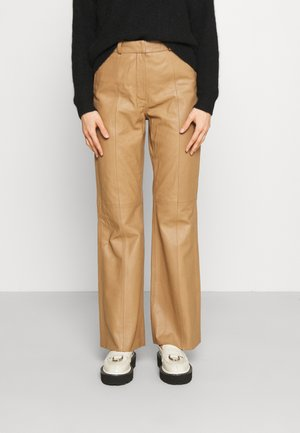 ASH DAILY - Leather trousers - tigers eye