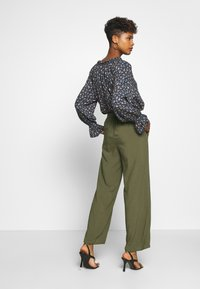 ONLY - ONLNOVA LIFE PALAZZO PANT SOLID - Trousers - grape leaf - 2
