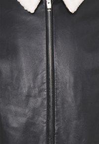 sandro - Leather jacket - noir - 2