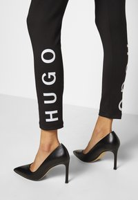 HUGO - Leggings - Trousers - black - 5