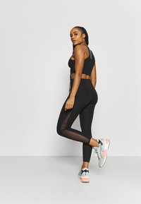 Puma - EVOSTRIPE HIGH WAIST - Tights - black - 2