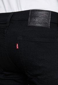 Levi's® - 519™ EXTREME SKINNY FIT - Jeans Skinny Fit - black denim - 4
