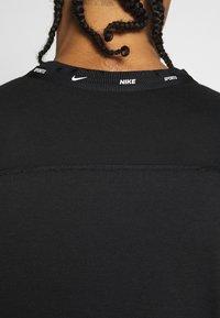 Nike Performance - Camiseta estampada - black/white - 4