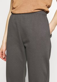 Nly by Nelly - COZY PANTS - Tracksuit bottoms - off black - 4