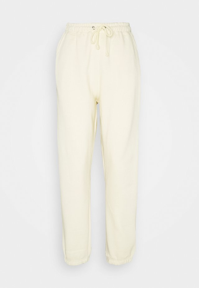 JOGGERS - Tracksuit bottoms - cream