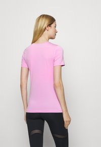 Nike Performance - ALL OVER - Basic T-shirt - beyond pink - 2