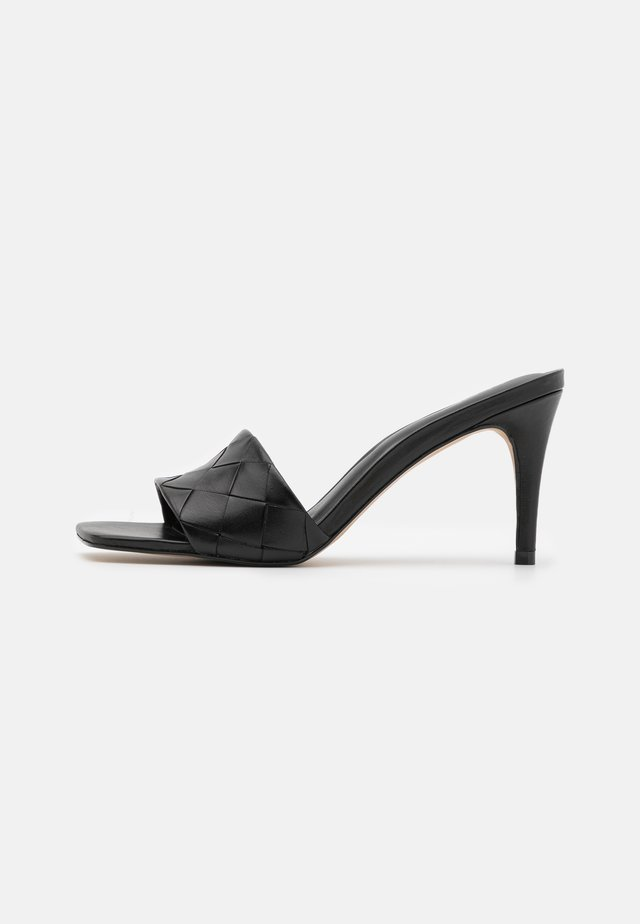 ACENDAN - Heeled mules - black