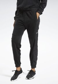 Reebok - MYT WARM-UP JOGGERS - Tracksuit bottoms - black - 0