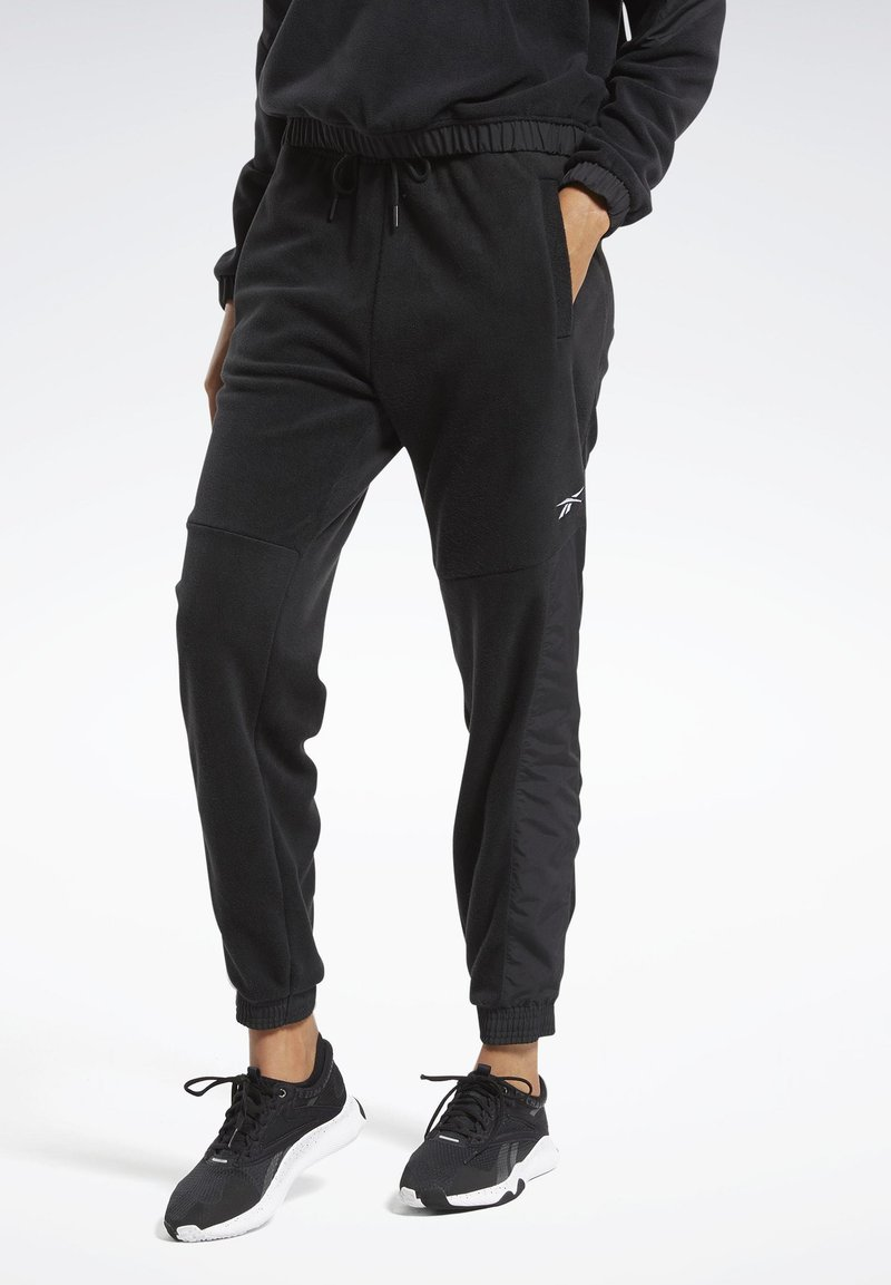 Reebok - MYT WARM-UP JOGGERS - Tracksuit bottoms - black