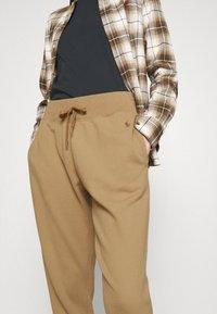 Polo Ralph Lauren - RHINESTONE LOOPBACK - Spodnie treningowe - boating khaki - 3
