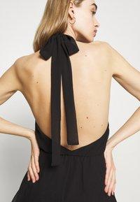 Gina Tricot - EXCLUSIVE MALVA HALTERNECK DRESS - Koktejlové šaty/ šaty na párty - black - 5