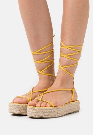 LARSEN - T-bar sandals - yellow