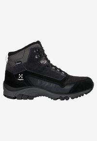 Haglöfs - SKUTA MID PROOF ECO - Hiking shoes - black - 4
