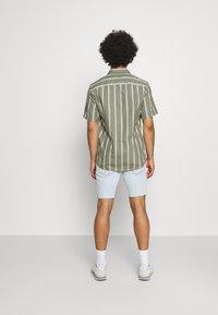 Levi's® - 412™ SLIM - Denim shorts - light blue denim - 3