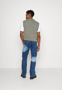 Jaded London - SPIRAL TIE DYE BOOTCUT - Straight leg jeans - blue - 2
