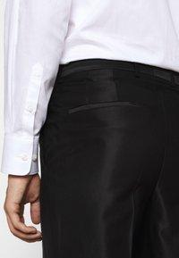 HUGO - GERMAN - Suit trousers - black - 3