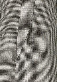 sandro - COUREY - Trousers - noir / blanc - 2
