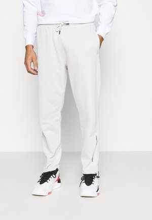 PRINTED BUNGY  - Tracksuit bottoms - stone