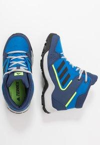 adidas Performance - TERREX HYPERHIKER TRAXION HIKING SHOES - Hiking shoes - glow blue/core black/signal green - 0