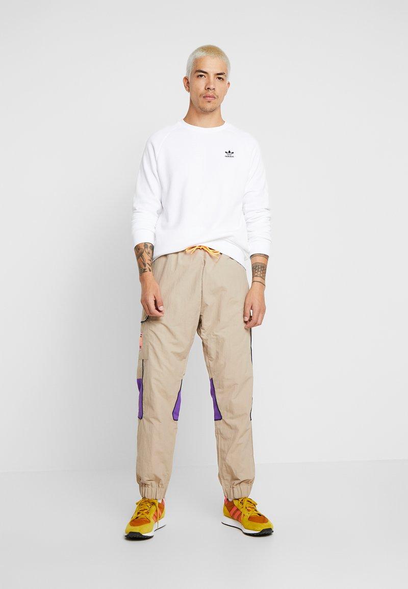 Sempre Canoa Manoscritto  adidas Originals REGULAR TRACK PANTS - Pantaloni cargo - beige - Zalando.it