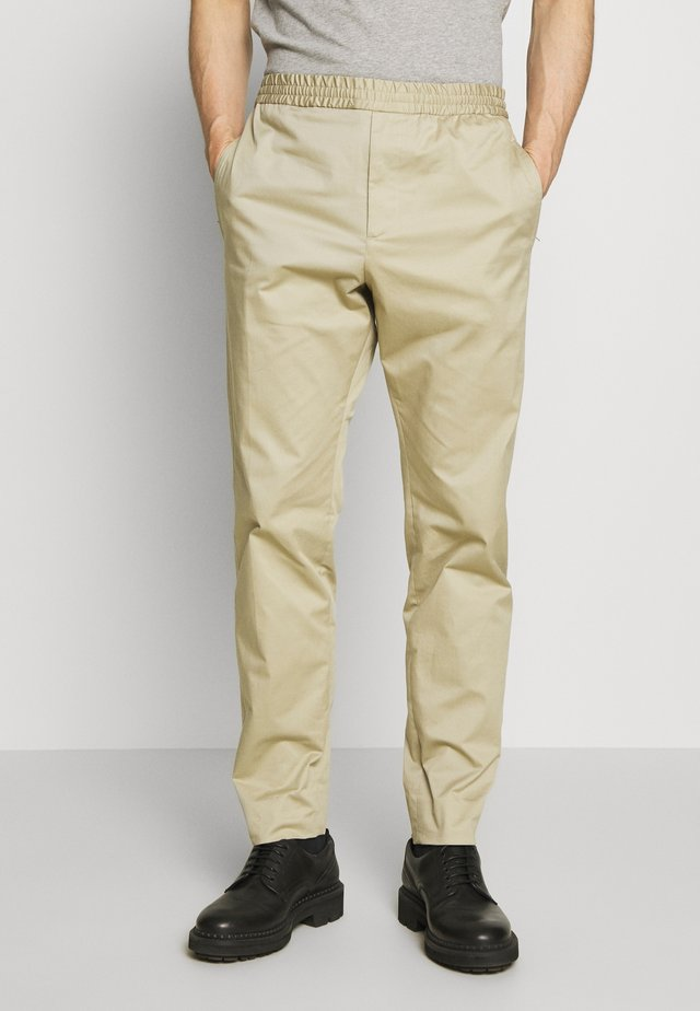 ETTRICK - Trousers - sand