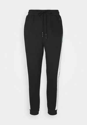 SIYAH - Tracksuit bottoms - black