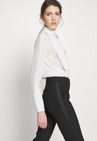 Victoria Victoria Beckham - SPLIT HEM TUXEDO TROUSER - Spodnie materiałowe - black - 3
