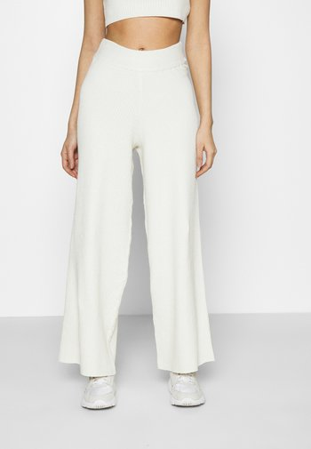 NA-KD X ZALANDO EXCLUSIVE SOFT RIBBED PANTS - Trousers - offwhite