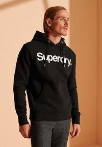 Superdry - Hoodie - black - 1