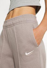 Nike Sportswear - TREND PANT - Tracksuit bottoms - moon fossil - 5