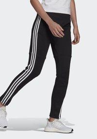 adidas Performance - ADIDAS SPORTSWEAR 3-STRIPES SKINNY PANTS - Pantalon de survêtement - black/white - 2
