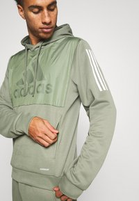 adidas Performance - MUST HAVES AEROREADY  - Hoodie - leggrn - 4