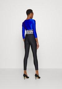 Versace Jeans Couture - PANTS - Leggings - Trousers - black - 4