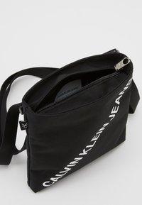 Calvin Klein Jeans - FLATPACK  - Across body bag - black - 2