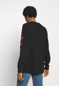 Merchcode - LADIES CHINESE LETTERS LONGSLEEVE - Long sleeved top - black - 2