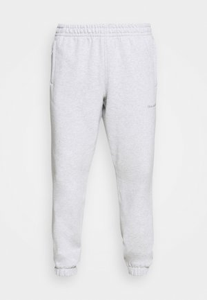 BASICS UNISEX - Tracksuit bottoms - light