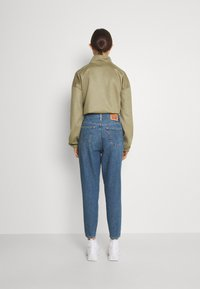 Levi's® - HIGH WAISTED MOM JEAN - Jeans Tapered Fit - eco blue - 2