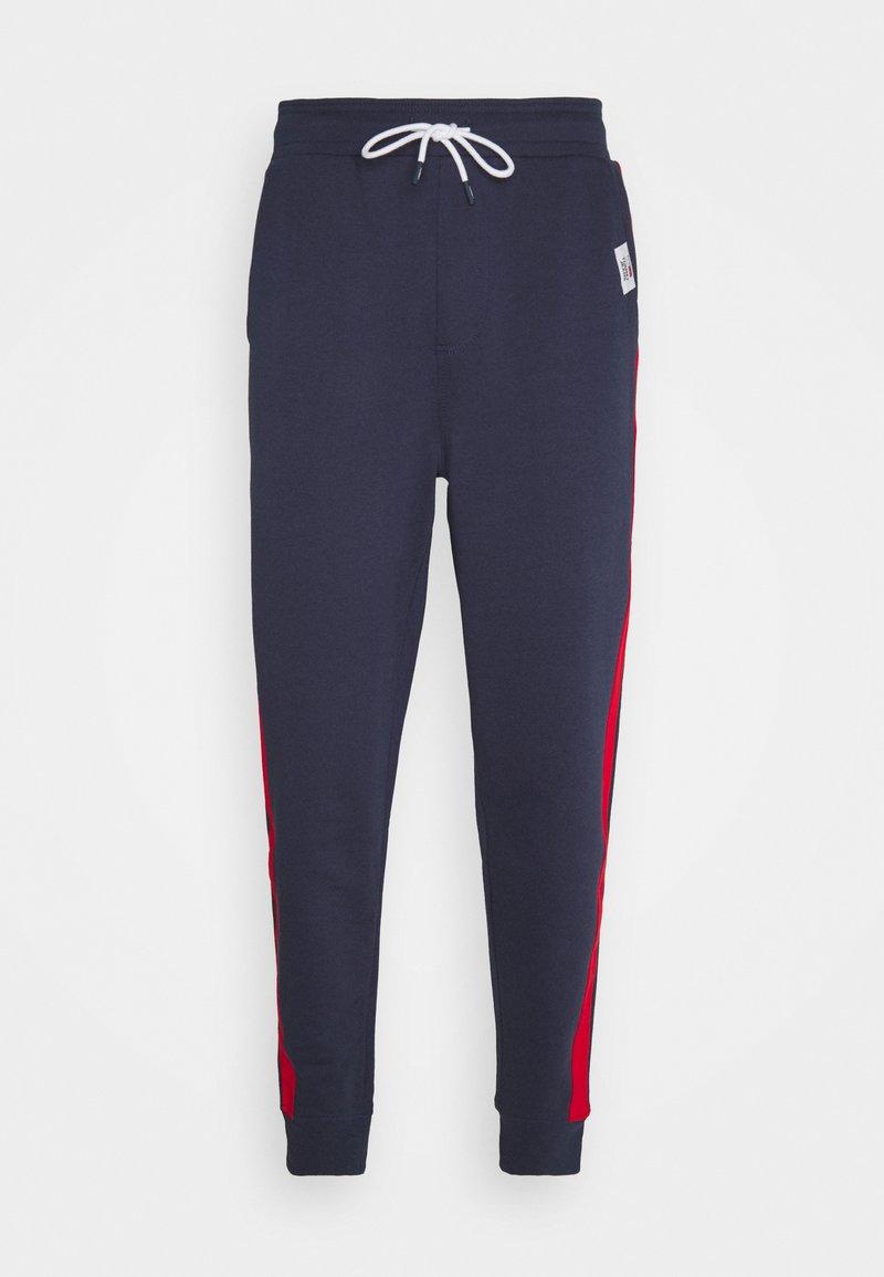 Tommy Jeans - MIX MEDIA BASKETBALL PANT - Pantaloni sportivi - twilight navy