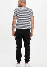 DeFacto - Cargo trousers - black - 2